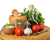 Pasta in a glass jar, spices and olive oil Stock Photo
