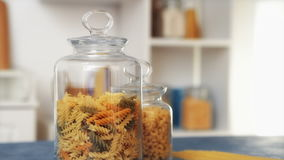 Pasta in glass jar on white background stock video