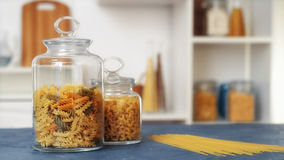Pasta in glass jar on white background Royalty Free Stock Images