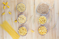 Pasta in glass plates. wheat grains. wheat spikelets. Pasta in glass plates. Vermicelli. wheat grains. wheat spikelets. Flat lay stock images