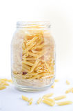 Pasta in a glass pot Stock Photos