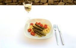 Pasta with a glass of white wine Royalty Free Stock Images