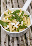 Pasta with goatcheese and rocket Stock Photos