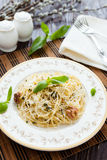 Pasta with grated Parmesan cheese and walnuts Stock Photo