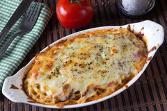 Pasta gratin. Spaghetti pasta gratin with mozarella cheese Stock Image
