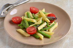 Pasta with green beans, cherry tomatoes and basil Stock Image