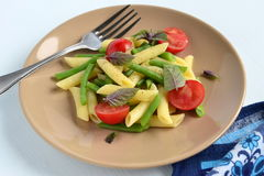 Pasta with green beans, cherry tomatoes and basil Royalty Free Stock Photography