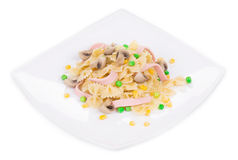 Pasta with green peas and corn. Stock Image