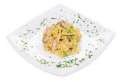 Pasta with green peas and corn. Stock Photography
