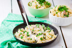 Pasta with green peas, tuna  and creamy sauce Stock Photos