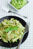 Pasta with green pesto Royalty Free Stock Photos