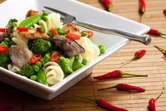 Pasta with green vegetables Stock Photo