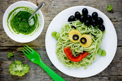 Pasta with green vegetables pesto shaped Frankenstein - healthy Stock Images