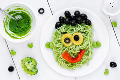 Pasta with green vegetables pesto shaped Frankenstein monster - Royalty Free Stock Photos