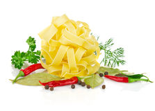 Pasta with greenery and spice Stock Images