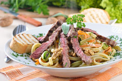 Pasta with grilled beef tenderloin Royalty Free Stock Image
