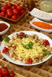 Pasta with grilled chicken royalty free stock images