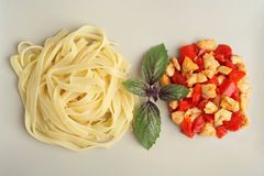 Pasta with grilled chicken and peppers. Chicken Pasta with basil and pepper decorations. Pasta top view. Stock Image