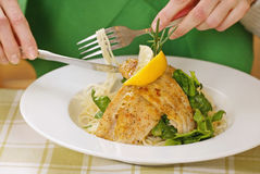 Pasta with grilled fish. On white plate royalty free stock photography