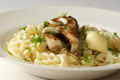 Pasta with grilled salmon steak Royalty Free Stock Photos