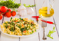Pasta with grilled shrimp and arugula Stock Images