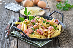 Pasta with ham Stock Photography