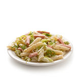 Pasta with ham and iceberg lettuce Stock Photos