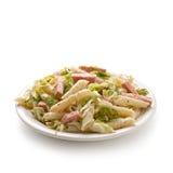 Pasta with ham and iceberg lettuce Stock Photos