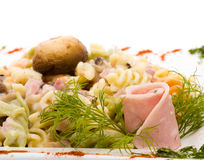 Pasta with ham and mushrooms Royalty Free Stock Images
