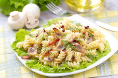 Pasta with ham and mushrooms Royalty Free Stock Photo