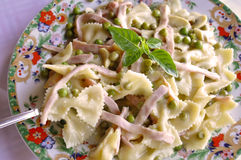 Pasta with Ham and Peas Stock Images