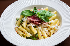 Pasta with hamon and goat cheese royalty free stock photography