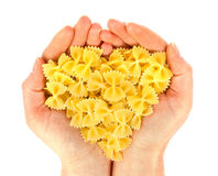 Pasta in hand view heart. Royalty Free Stock Photography