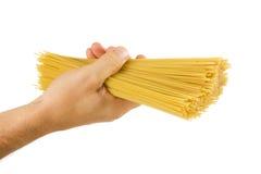 Pasta in hands Stock Photos
