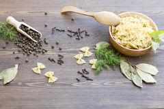 Pasta with herbs and spices. On dark wooden table royalty free stock photo