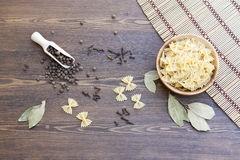 Pasta with herbs and spices. On makisu stock photo