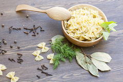 Pasta with herbs and spices. On wooden table stock photography
