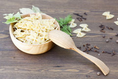 Pasta with herbs and spices. On wooden table stock photos