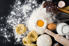 Pasta homemade raw and ingredients for pasta. Flour, eggs, milk and Parmesan cheese Royalty Free Stock Photography