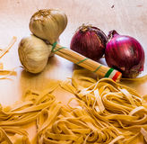 Pasta and Ingradient. Fettuccine or tagliatelle cut ready to cook and vegetables Royalty Free Stock Photos