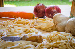Pasta and Ingradient. Fettuccine or tagliatelle cut ready to cook with vegetables Royalty Free Stock Images