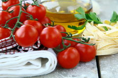 Pasta ingredient olive oil, tomato Stock Image