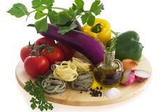 Pasta ingredients. (paglia (round pasta), tomato, eggplant, bell pepper, salt, pepper, onion, garlic, olive oil, celery) on wooden board Stock Images