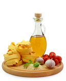 Pasta ingredients. On wooden board stock photography