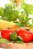 Pasta ingredients. Pasta with tomatoes and basil royalty free stock image