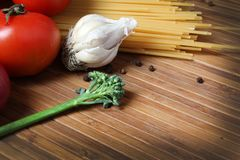 Pasta and ingredients. Beautiful shot of wheat pasta with vegetables Stock Image