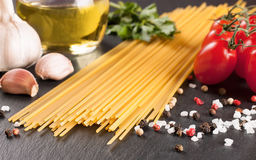 Pasta ingredients on black background. stock photography