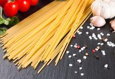 Pasta ingredients on black background. royalty free stock photo