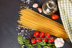 Pasta ingredients on black background. stock photos