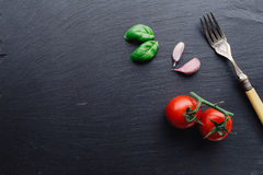 Pasta ingredients on black slate background Stock Photography